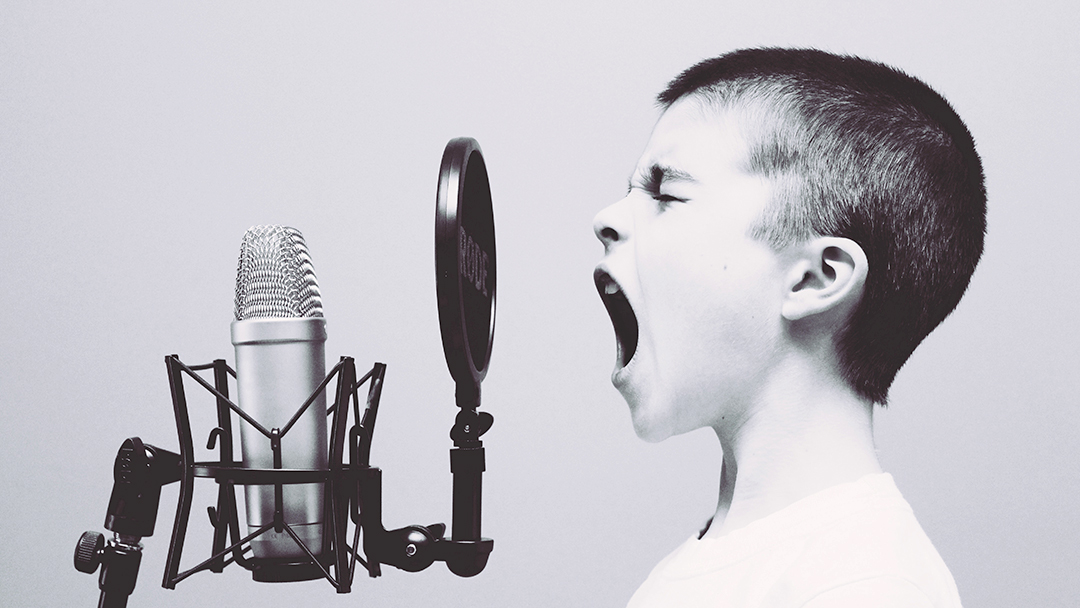 boy on microphone using voice